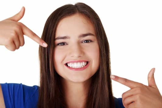 girl showing her white teeth