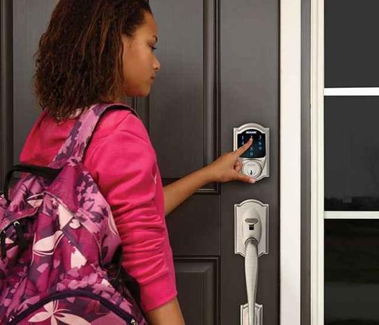 lady opening a door with a smart door lock