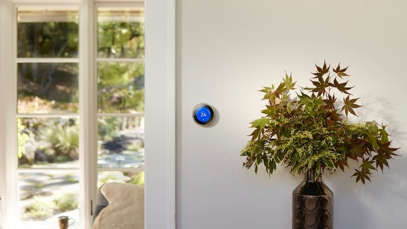 smart wifi thermostat on a wall