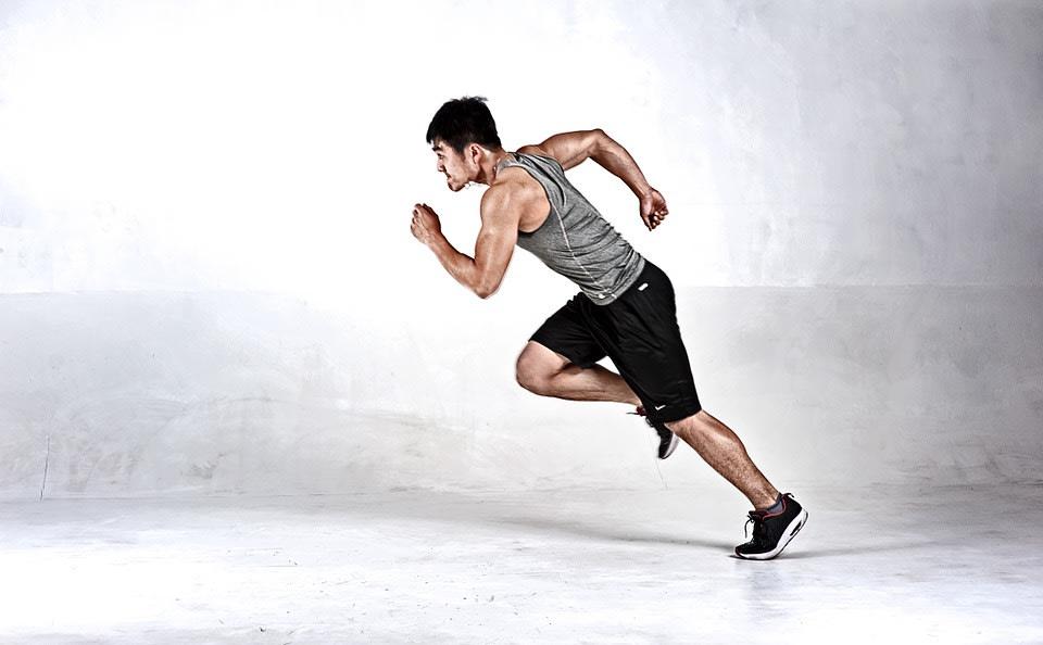 Man wearing a black workout shorts