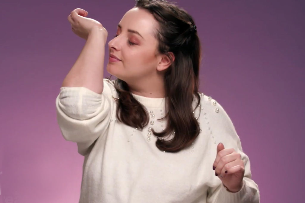 Woman taking a sniff of her wrist