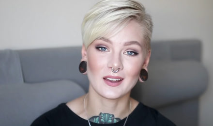 Woman with a tattoo on the neck and platinum blonde hair
