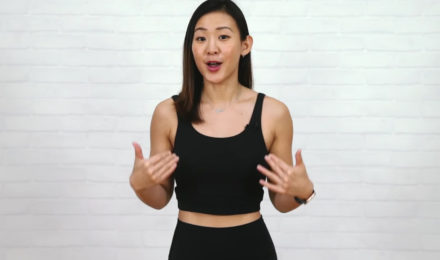 Female fitness instructor wearing black sports apparel