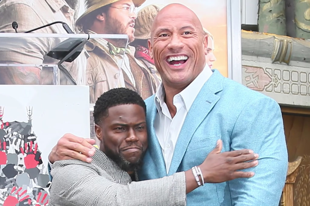 Man and The Rock posing for a photo